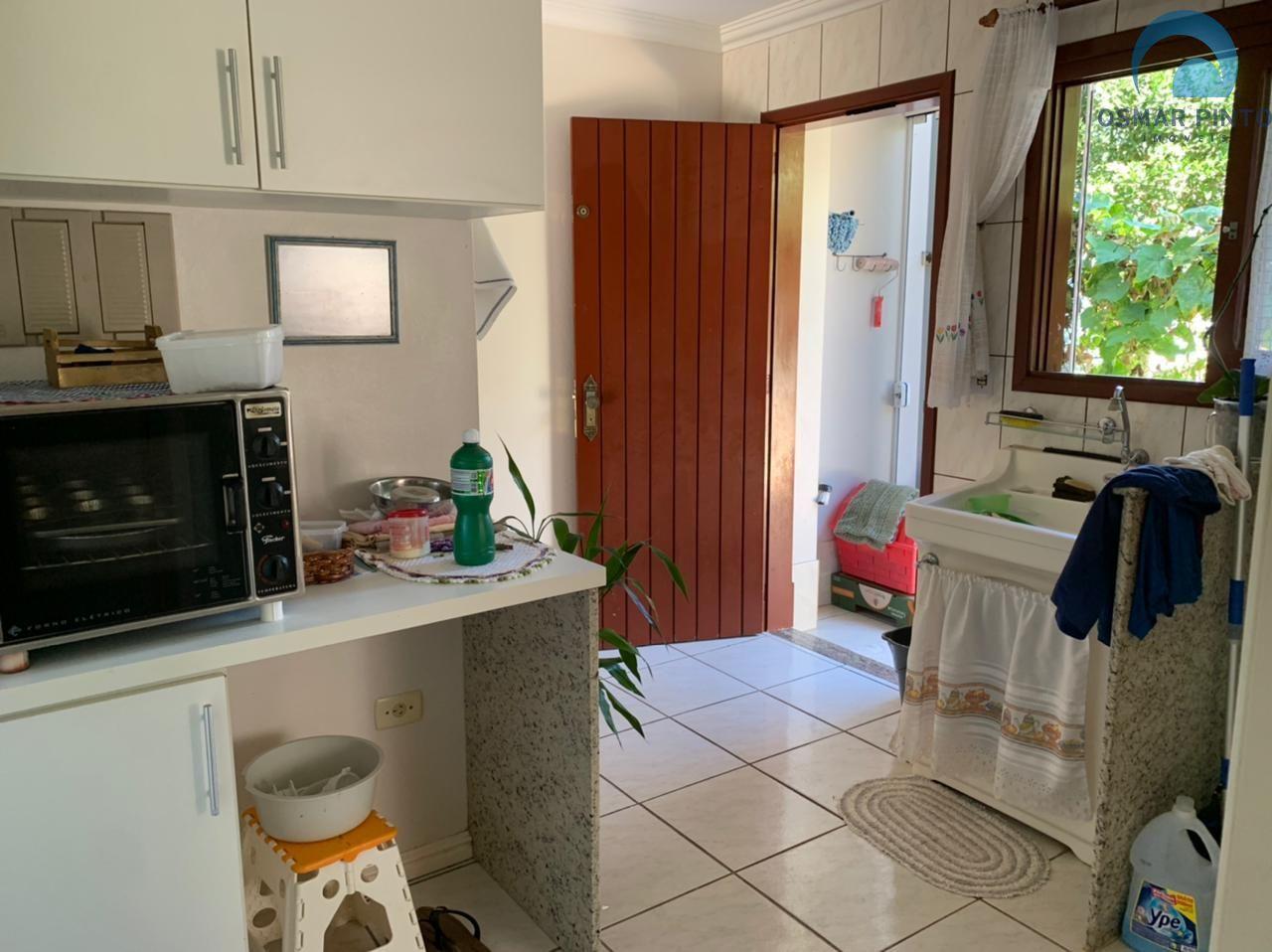 Casa 5 dormitórios em Torres, no bairro Centenário