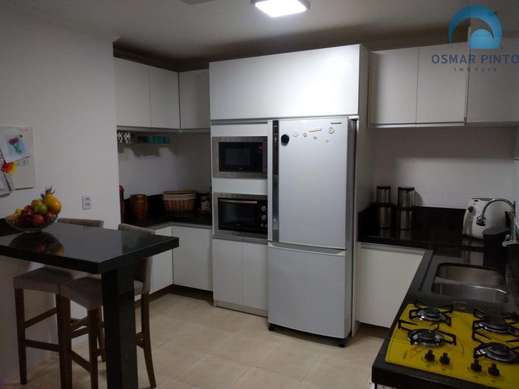 Casa 4 dormitórios em Torres, no bairro Guarita