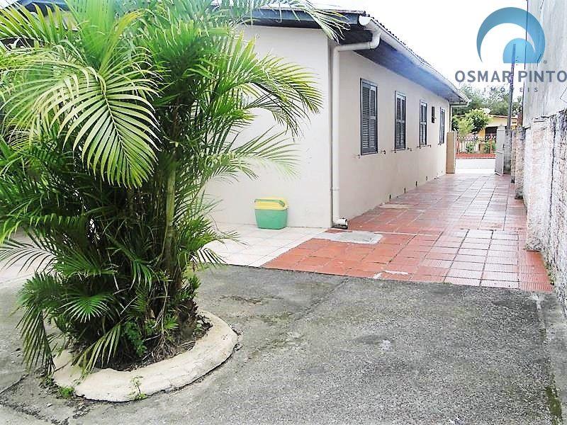 Casa com 4 dormitórios<small> em Torres, Centro</small>
