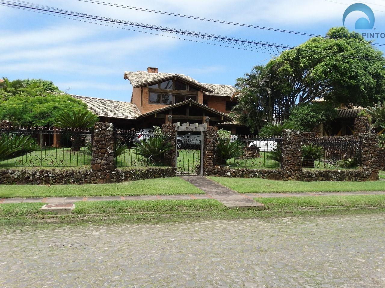 Casa 5 dormitórios em Torres, no bairro Praia Grande