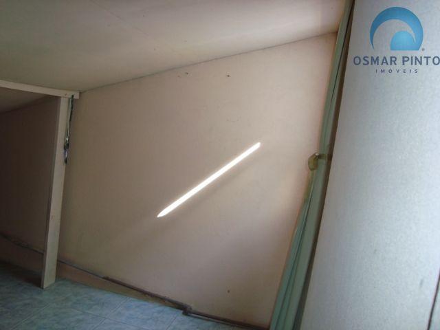 Casa com 2 dormitórios<small> em Torres, Centro</small>