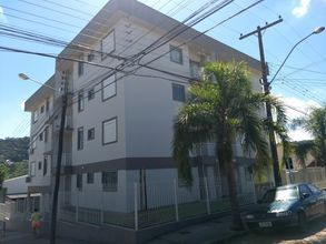 fachada - frente sul - sol sul e oeste - prédio de esquina